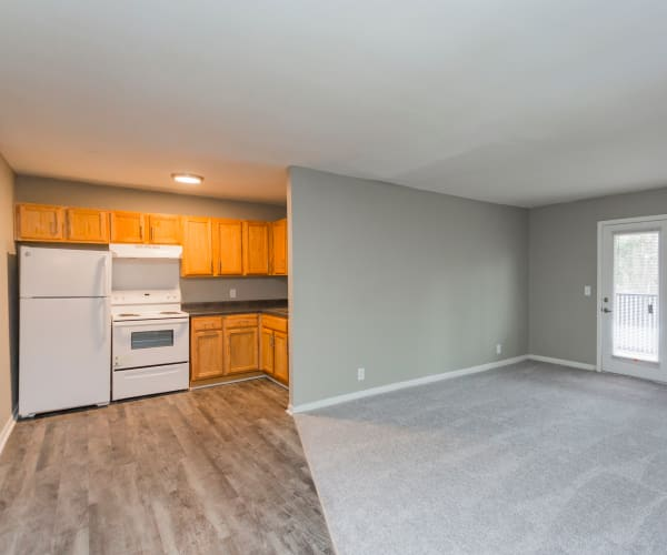 Kitchen and living room at Gibson Creek Apartments in Madison, Tennessee