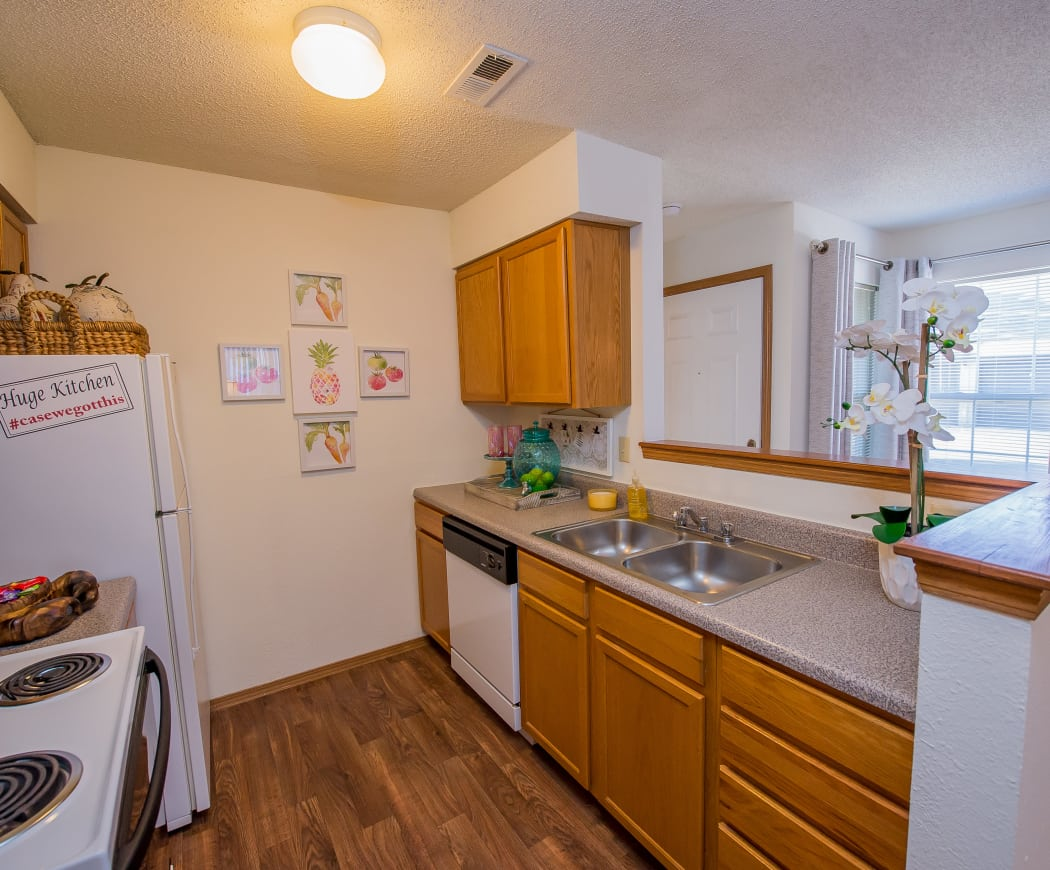 Kitchen with white appliances at Huntington Park Apartments in Wichita, Kansas