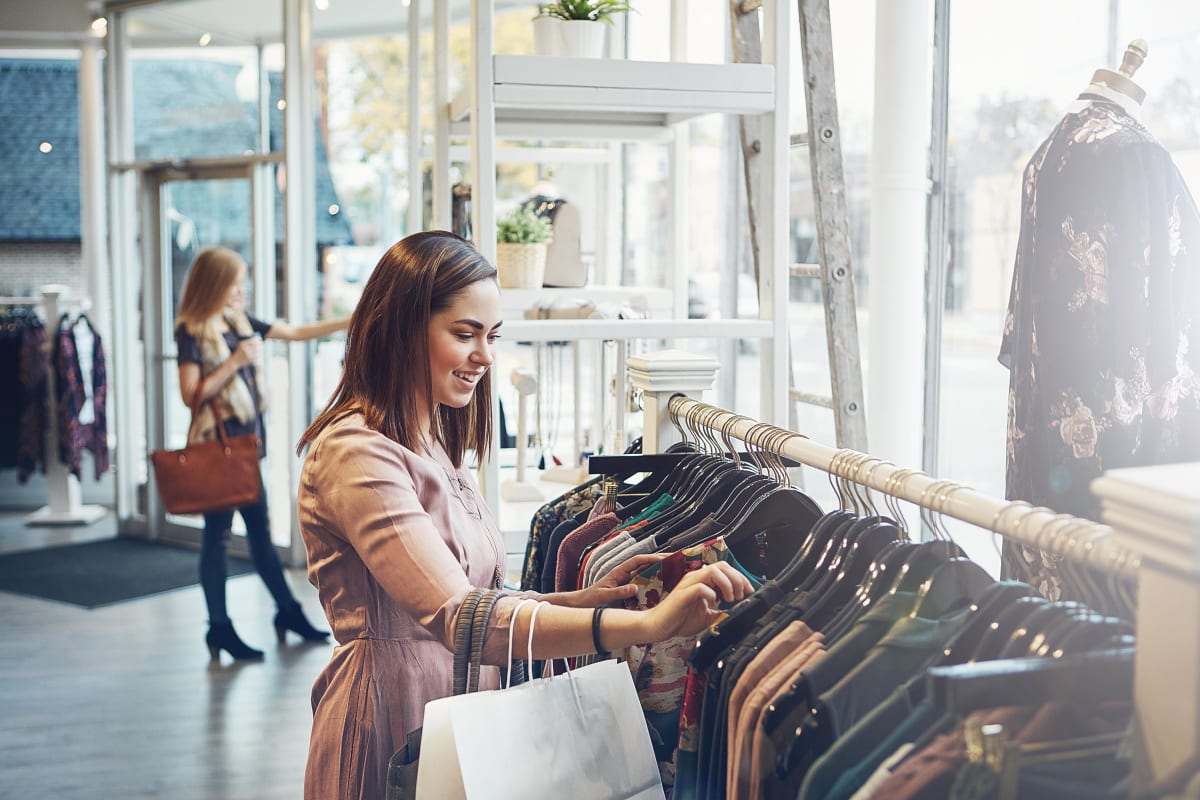 Young professional woman out shopping at a local store in Morton Grove, Illinois near The Residences at Sawmill Station