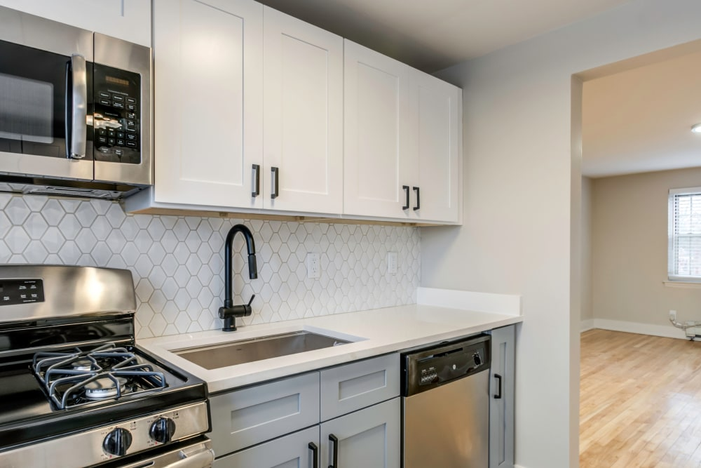 Kitchen with stainless-steel appliances and cream-colored cabinetry at Haven New Providence in New Providence, New Jersey
