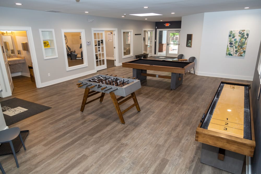 A community  clubhouse with a game room at Sunbrook Apartments in Saint Charles, Missouri
