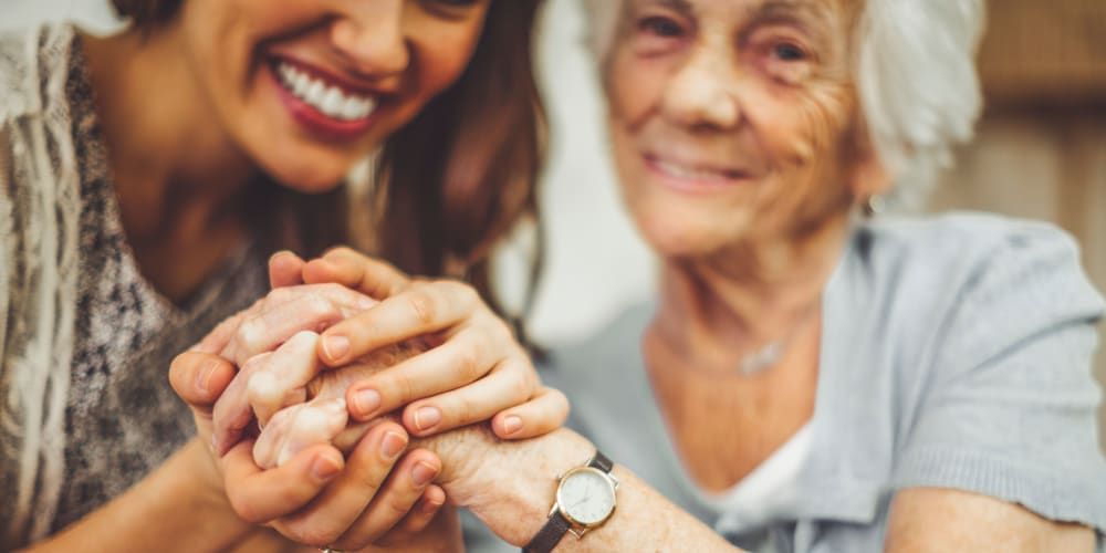A resident and daughter holding hands at Careage Home Health in Bellevue, Washington.