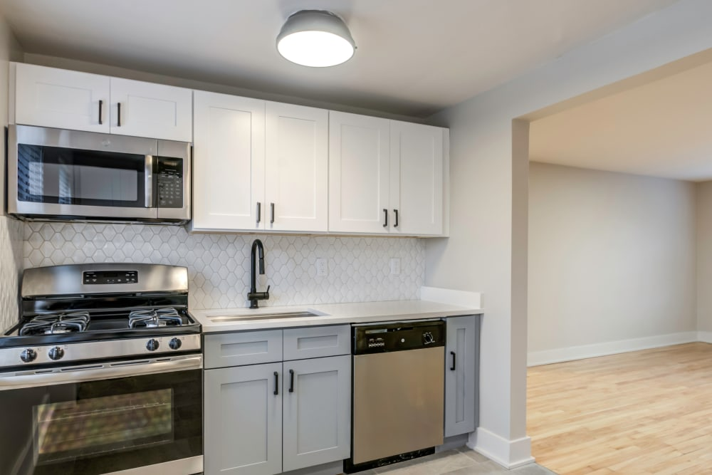 Kitchen with a white backsplash at Haven New Providence in New Providence, New Jersey