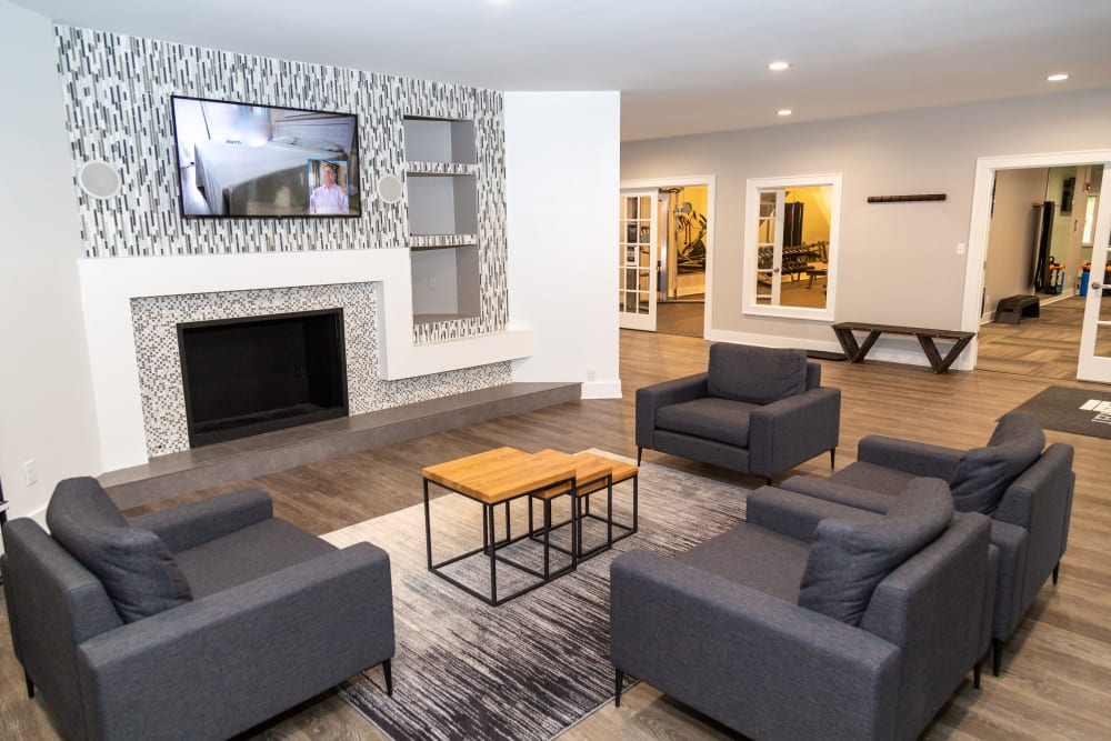 A clubhouse with a large fireplace at Sunbrook Apartments in Saint Charles, Missouri