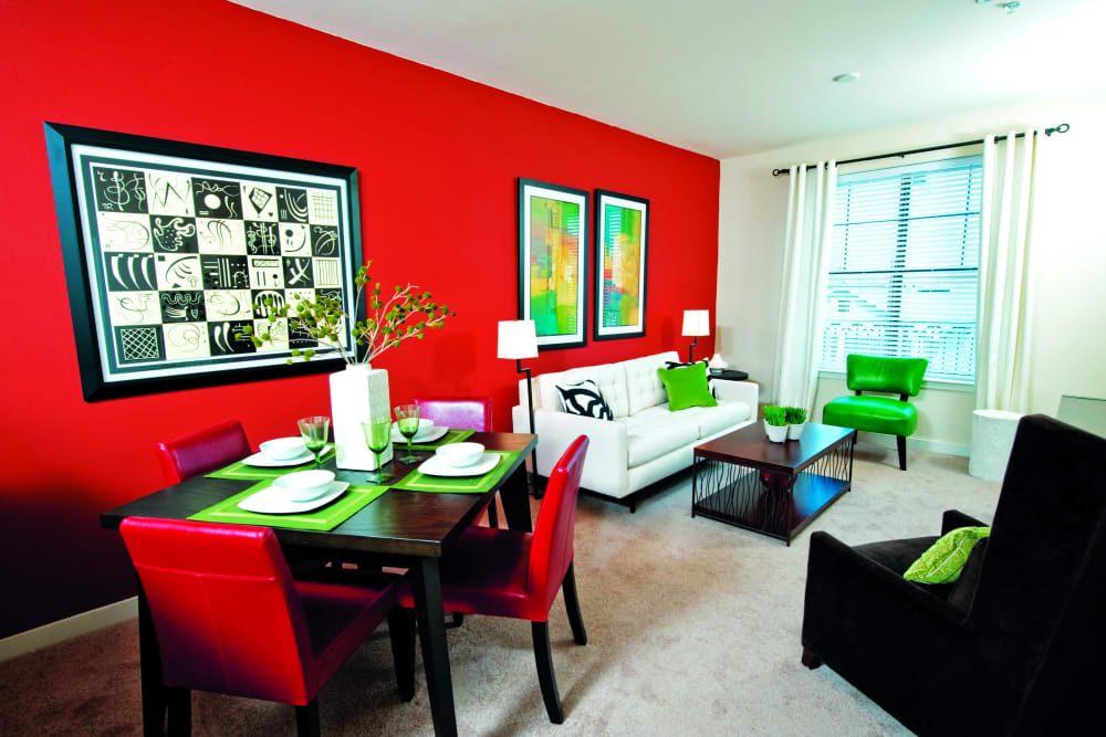 Dining room with red and green accents at The Preserve in New Orleans, Louisiana