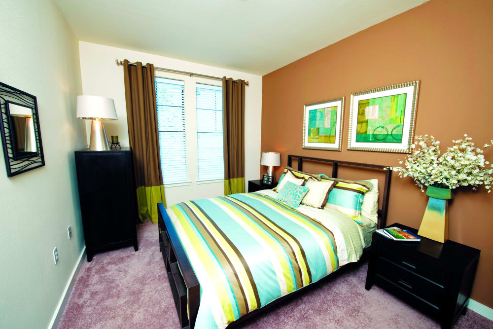 Model bedroom with green accents at The Preserve in New Orleans, Louisiana