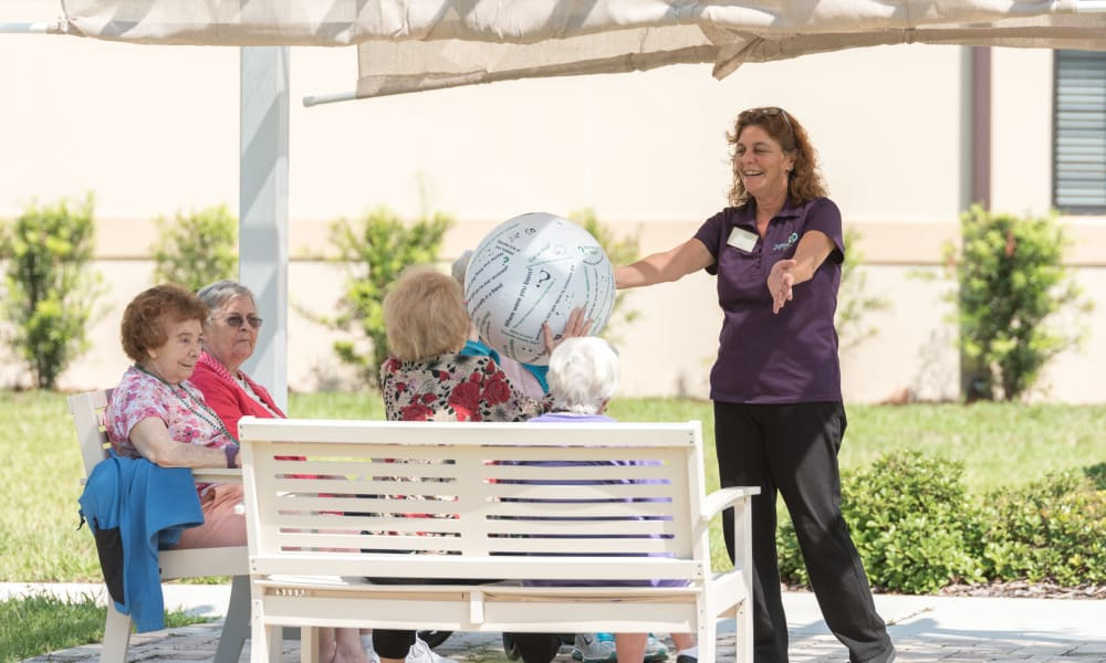 Residents playing a game at Inspired Living Hidden Lakes in Bradenton, Florida.