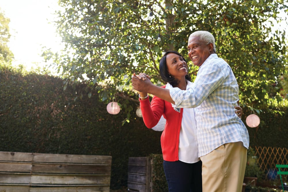 An elderly couple dancing together at Cypress Place in Ventura, California