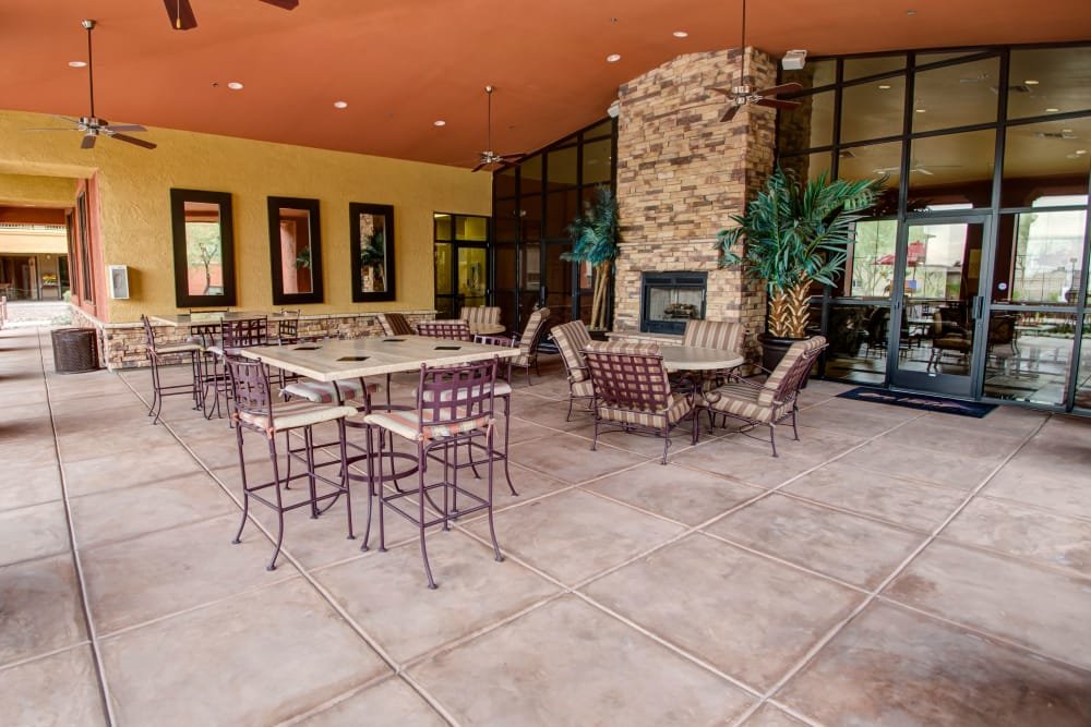 Community clubhouse with fireplace at Oro Vista Apartments in Oro Valley, Arizona