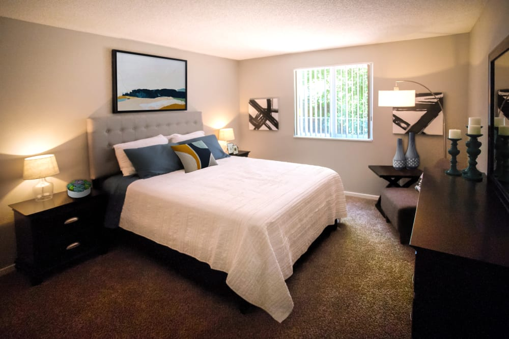 Well-furnished primary bedroom in a model home at Haven Apartment Homes in Kent, Washington