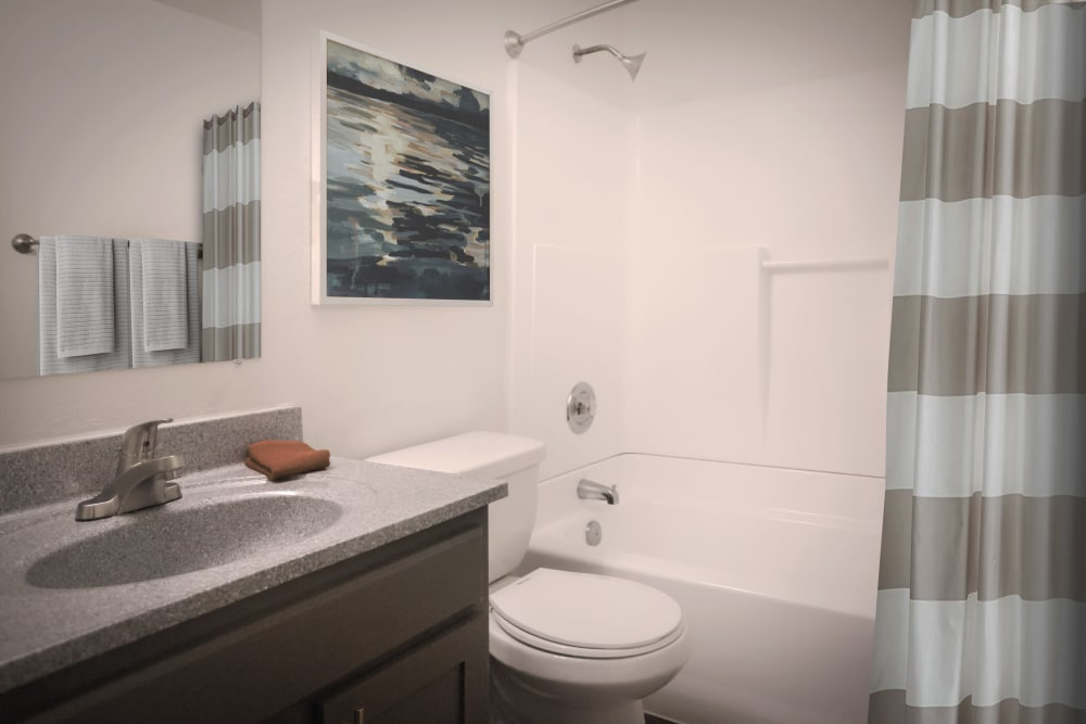 Bright bathroom in a model home at Haven Apartment Homes in Kent, Washington