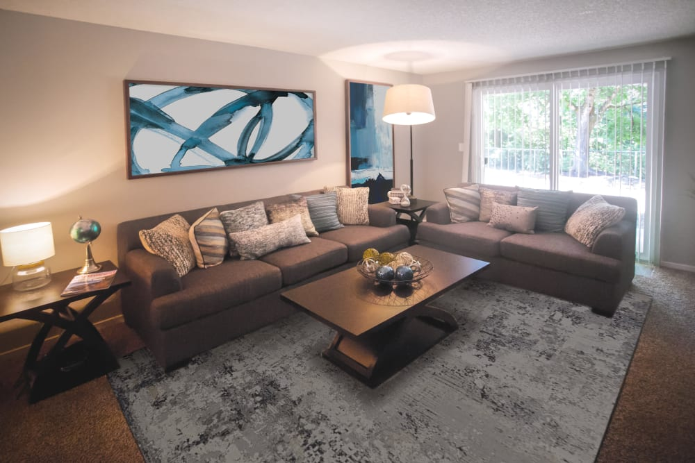 Spacious furnished living room with patio access at Haven Apartment Homes in Kent, Washington