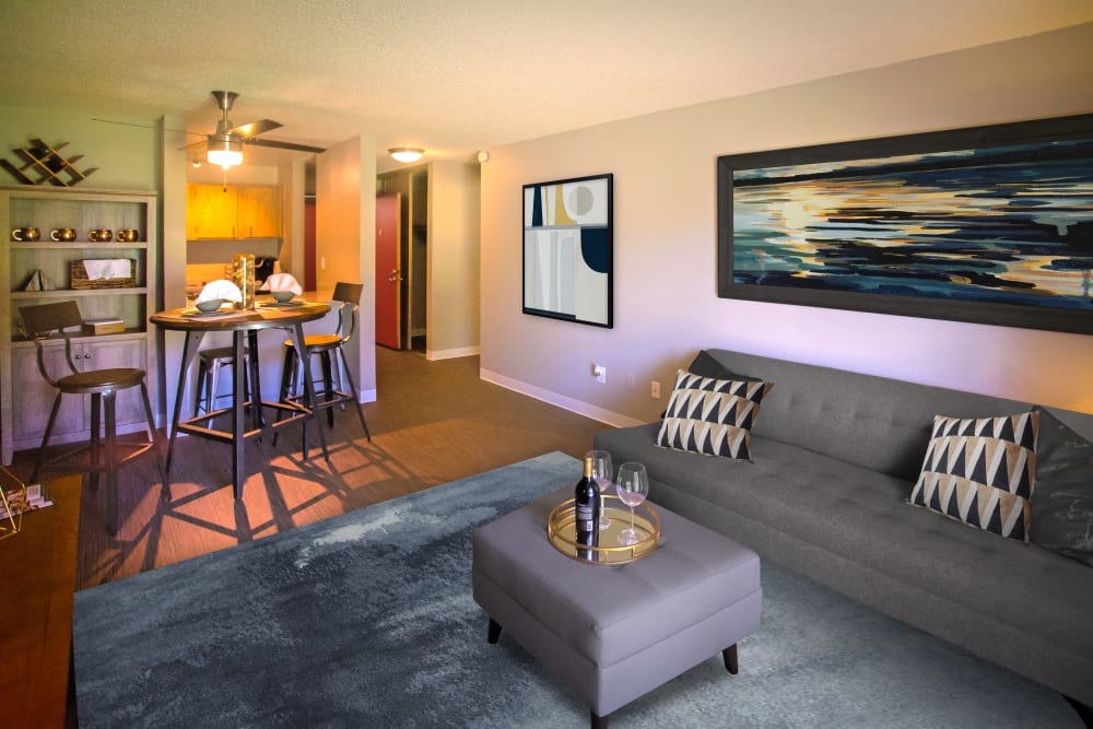 Open floor plan living and dining space areas at Terra Apartment Homes in Federal Way, Washington