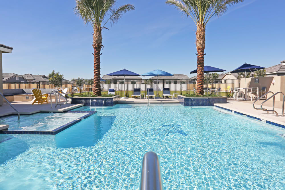 Swimming pool with sundeck at Christopher Todd Communities on Mountain View in Surprise, Arizona