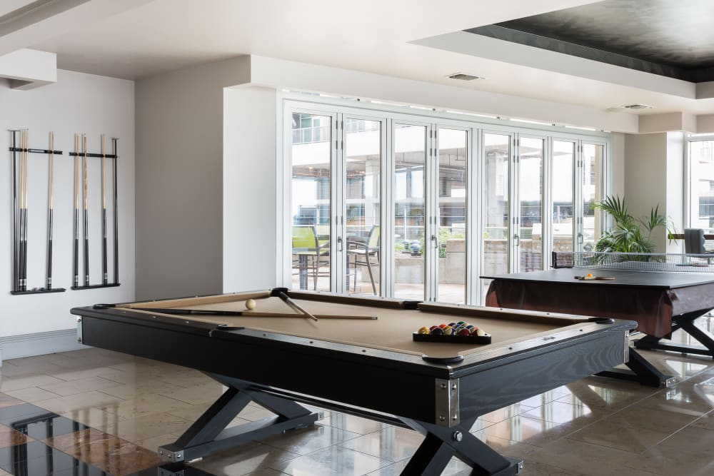 Billiards room with seating at The Heights at Park Lane in Dallas, Texas