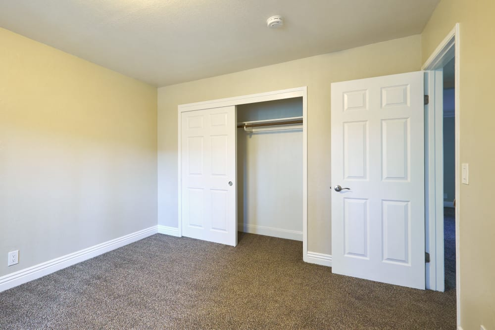 Bedroom with a spacious closet at Palms at the Pruneyard in Campbell, California