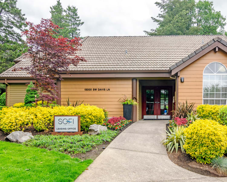Exterior view of the leasing office surrounded by well-maintained landscaping at Sofi Lake Oswego in Lake Oswego, Oregon