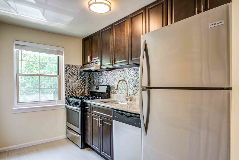 This spacious kitchen at Haven New Providence in New Providence, New Jerseyfeatures ample cabinet storage space