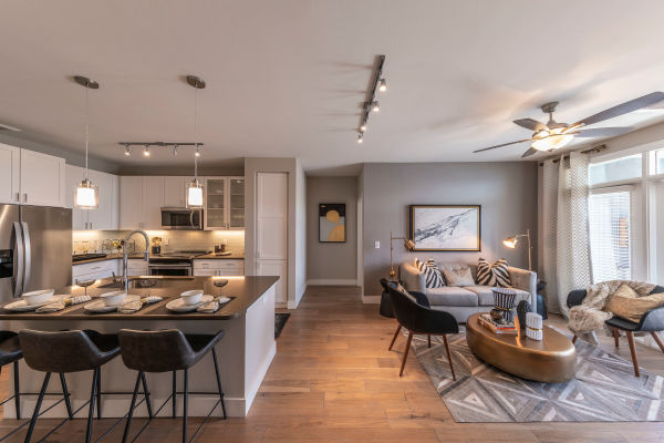 Beautiful open-concept layout with hand-scraped hardwood floors in a model home at Carter in Scottsdale, Arizona