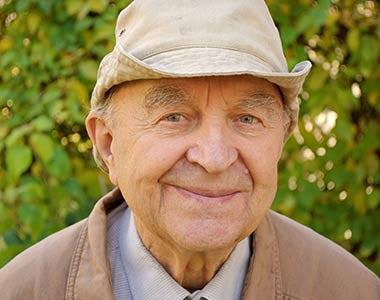 Male resident smiling at Mirror Lake Village Senior Living Community in Federal Way, Washington.
