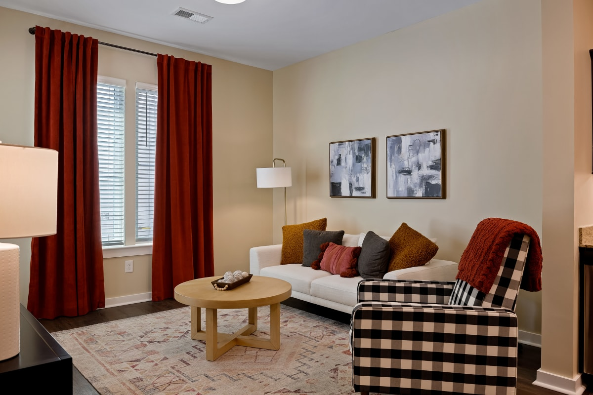 A spacious resident living room at The Claiborne at Brickyard Crossing in Summerville, South Carolina.