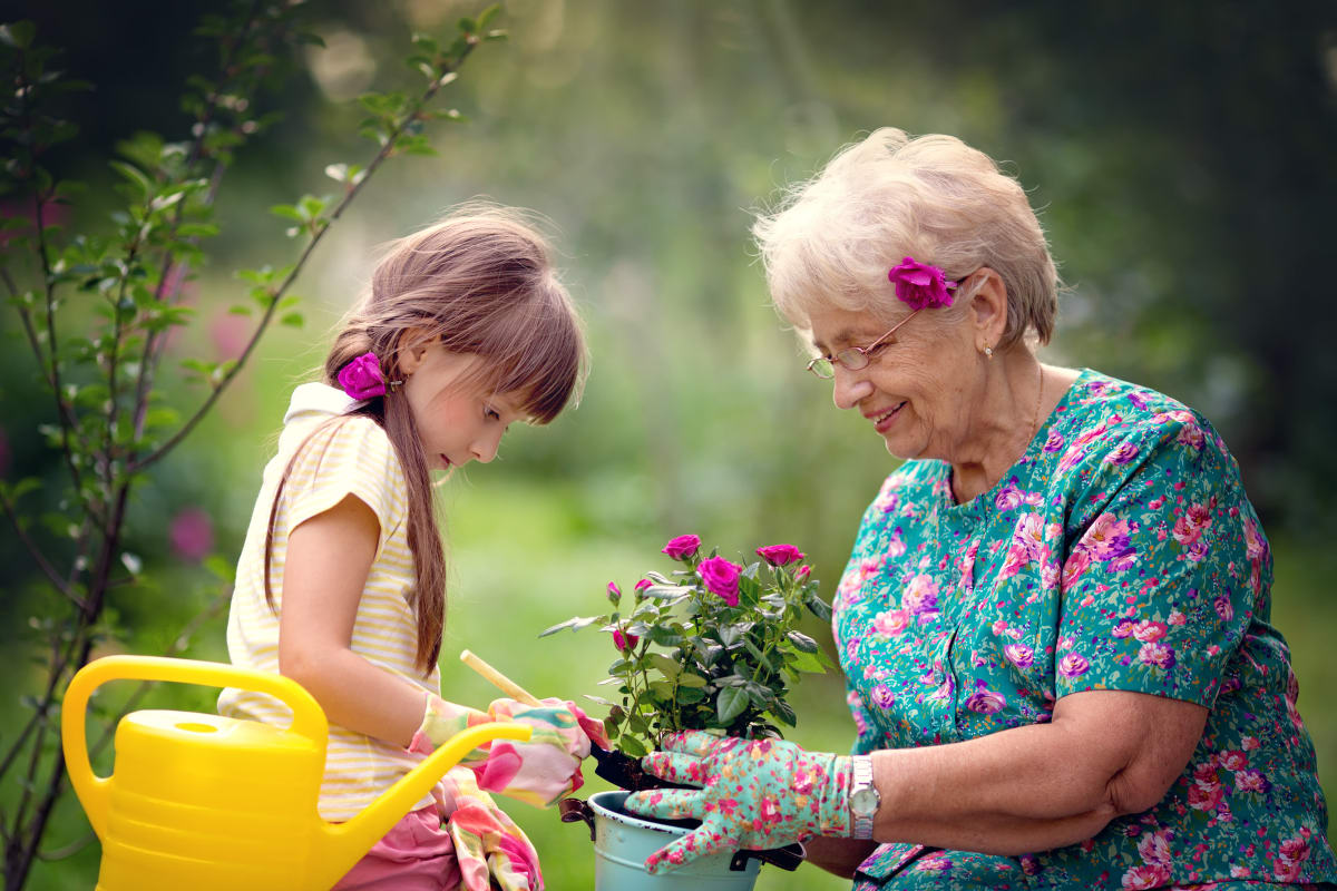 A resident and a small child planting flowers at Keystone Place at Terra Bella in Land O' Lakes, Florida