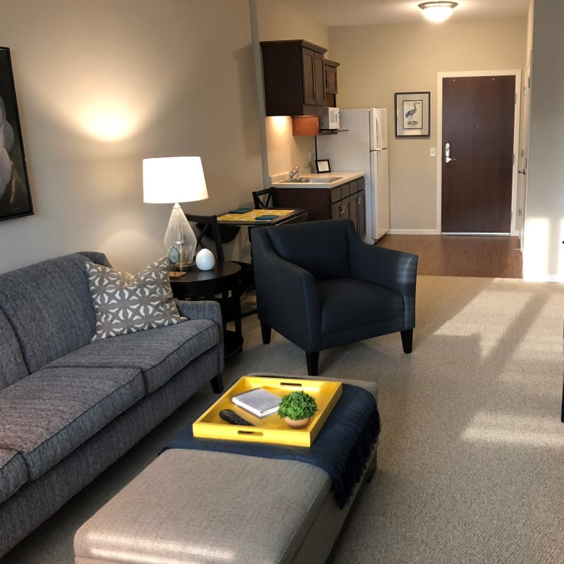 Modern living room and kitchenettes offered at The Sanctuary at Brooklyn Center in Brooklyn Center, Minnesota