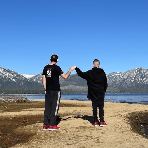 fist bump at a lake