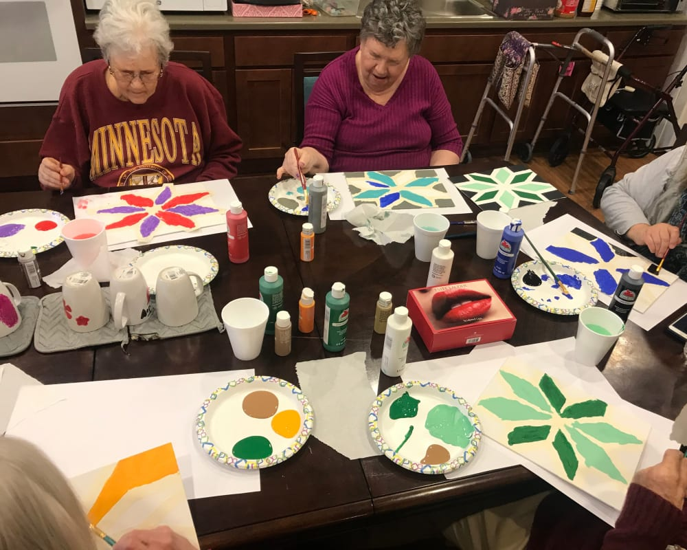 Resident enjoying an art class at Edencrest at Green Meadows in Johnston, Iowa.