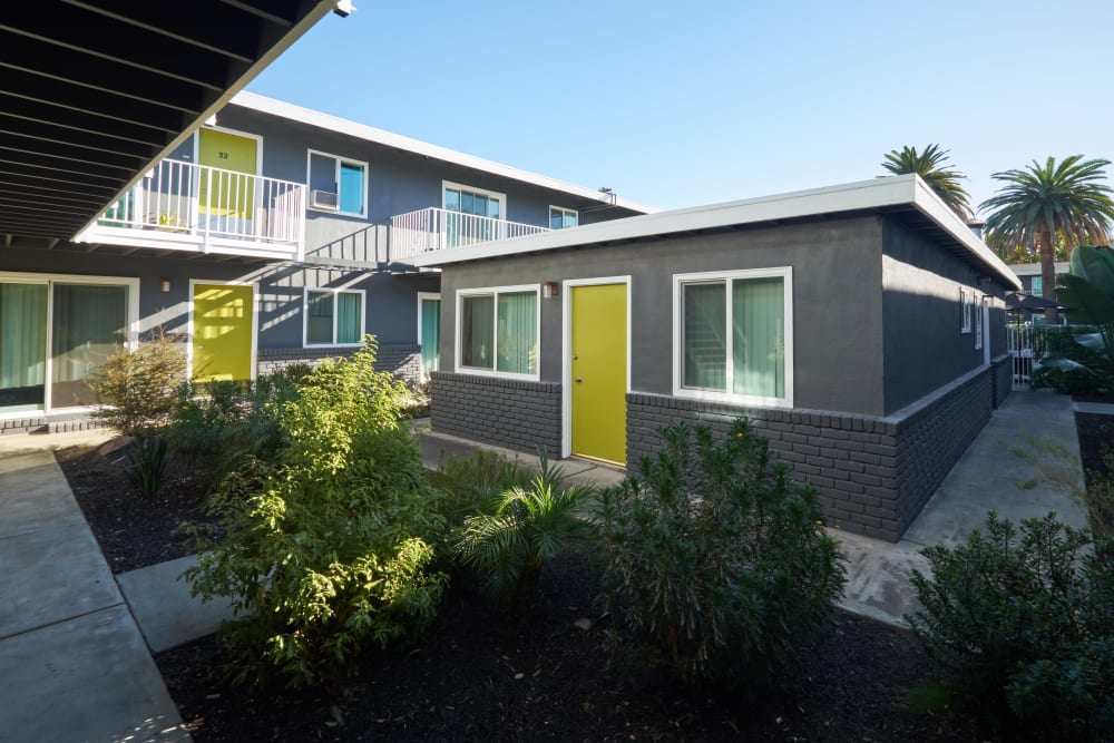 Exterior of building with spacious walkways at Palms at the Pruneyard in Campbell, California