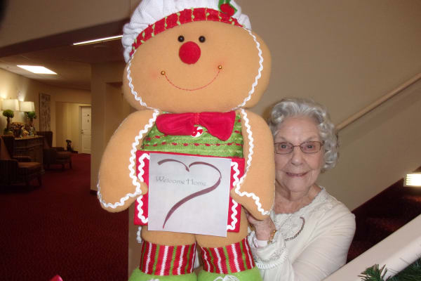 Resident holding a stuffed gingerbread man at Camden Springs Gracious Retirement Living in Elk Grove, California