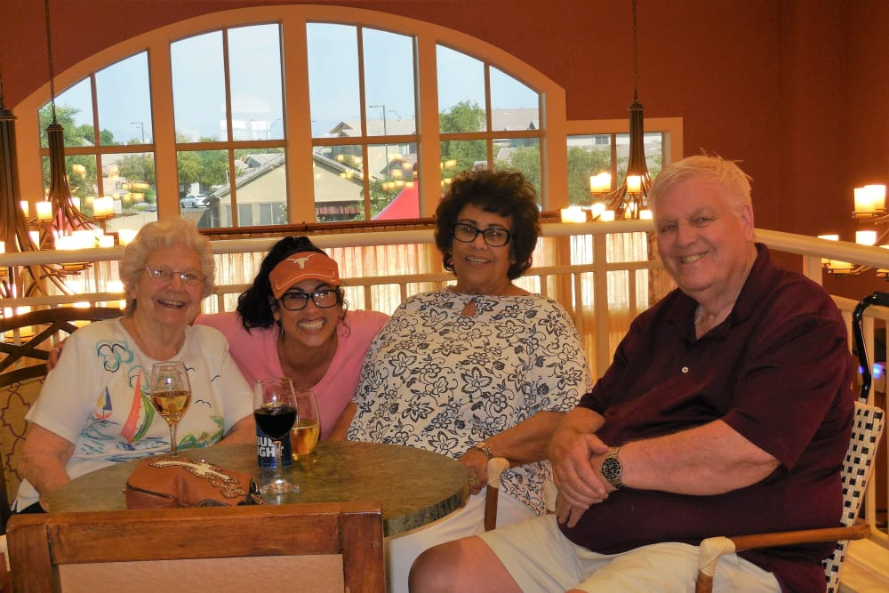 Residents and team members having lunch together at The Groves, A Merrill Gardens Community in Goodyear, Arizona.