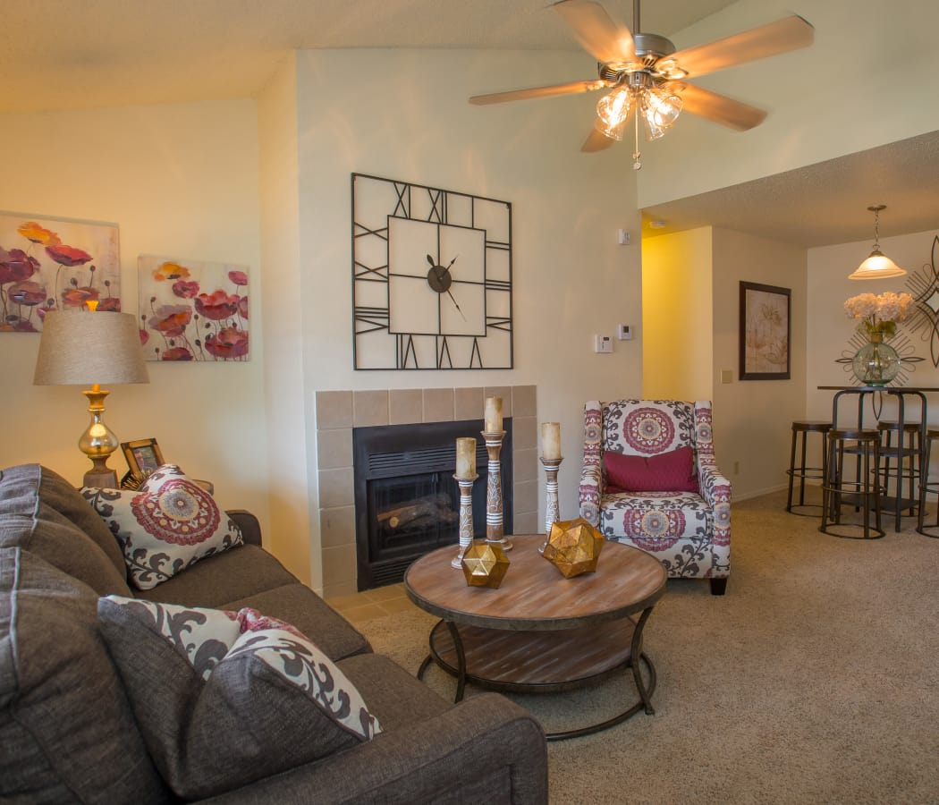 Living room with fireplace and ceiling fan in model home at Chardonnay in Tulsa, Oklahoma