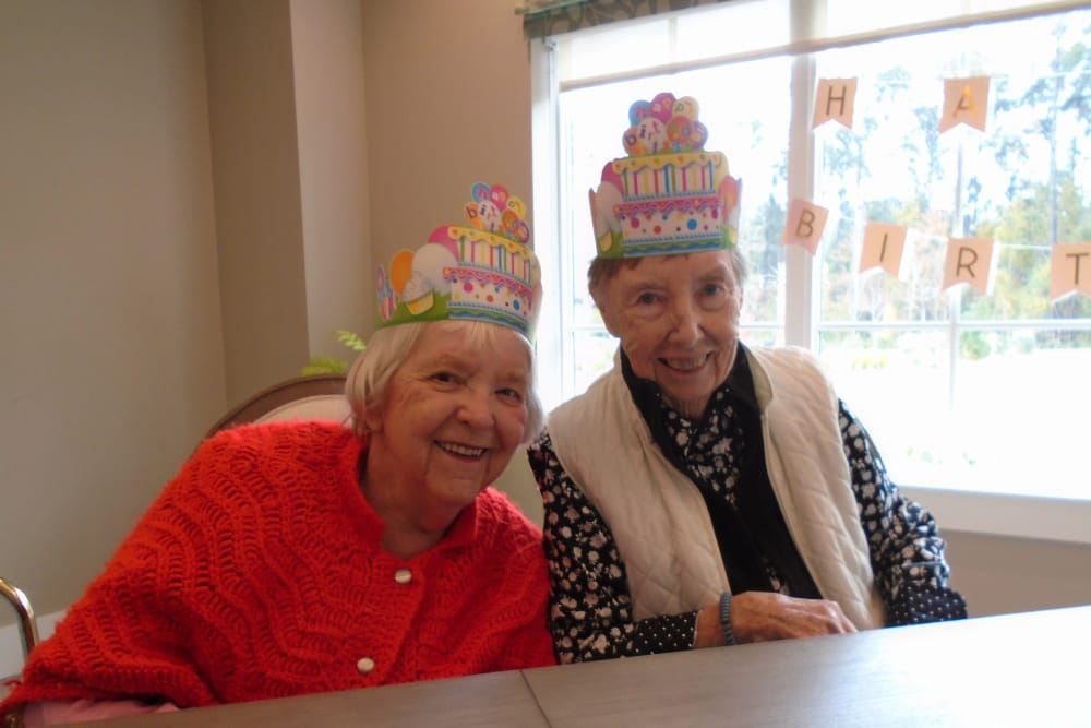 Ladies enjoying their birthday party at Merrill Gardens at Carolina Park in Mount Pleasant, South Carolina.