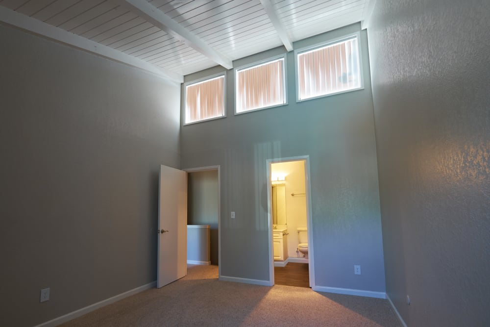 Bedroom with high ceilings at Breakwater Apartments in Santa Cruz, California