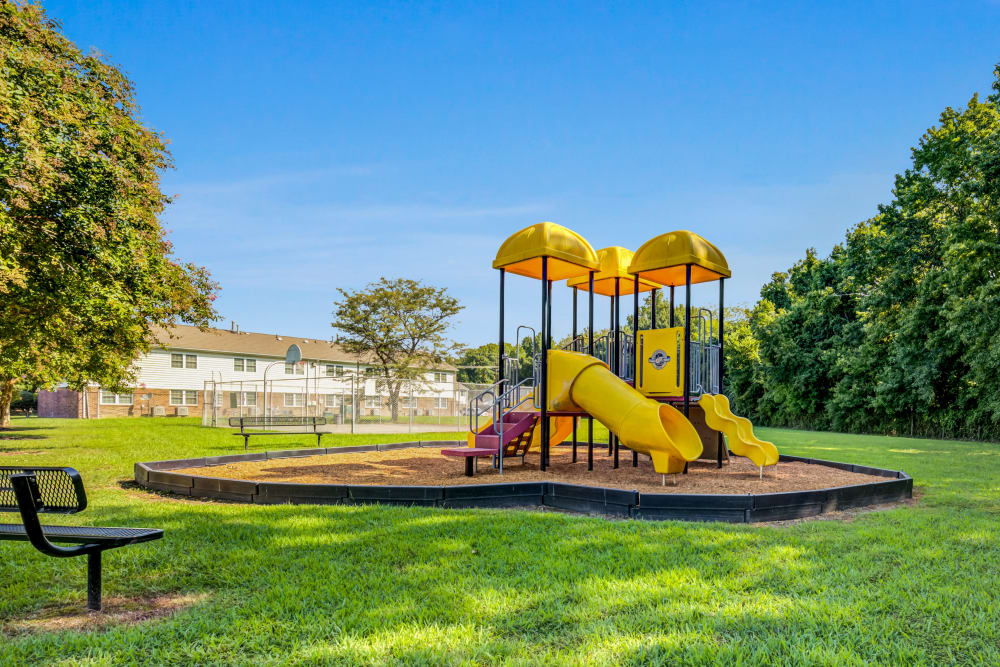 Kids playing on a playground at City Line Apartments in Newport News, Virginia