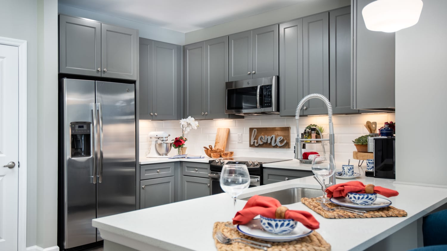 Modern kitchens at Avenida Cool Springs senior living apartments in Franklin, Tennessee