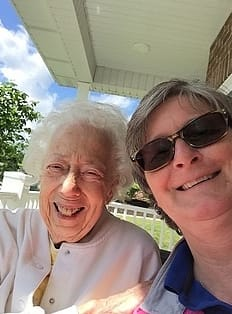 Happy resident and caregiver