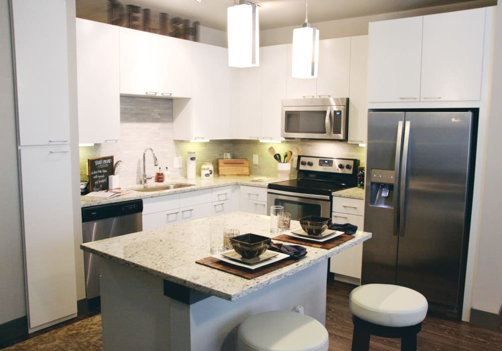 Axis at Wycliff showcase a modern and furnitured kitchen in Dallas, Texas