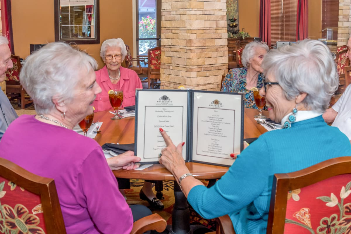 Residents saying cheers at The Landing at Stone Oak in San Antonio, Texas