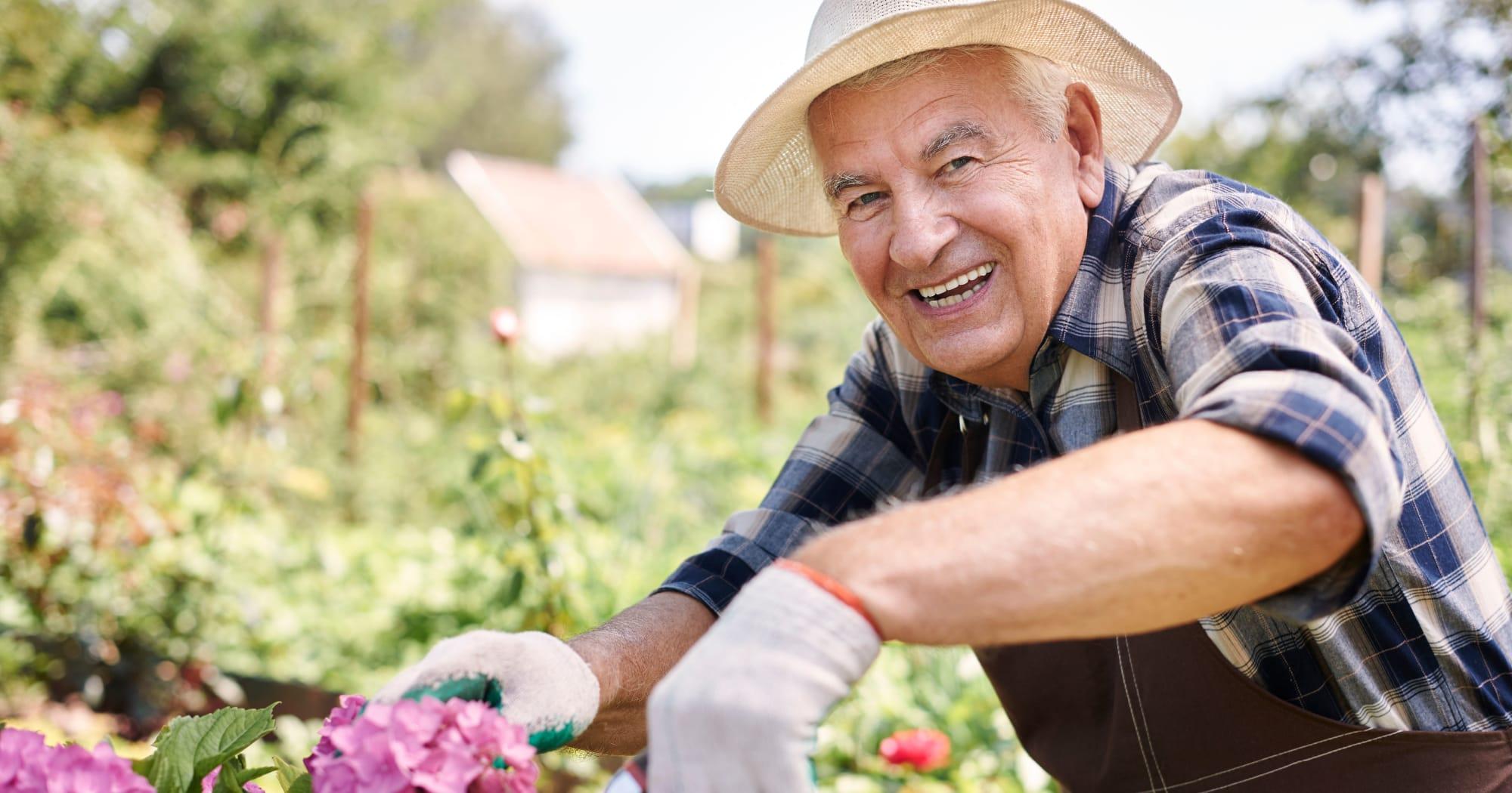 An elderly gentleman gardening outside at Brightwater Senior Living in Bend, Oregon
