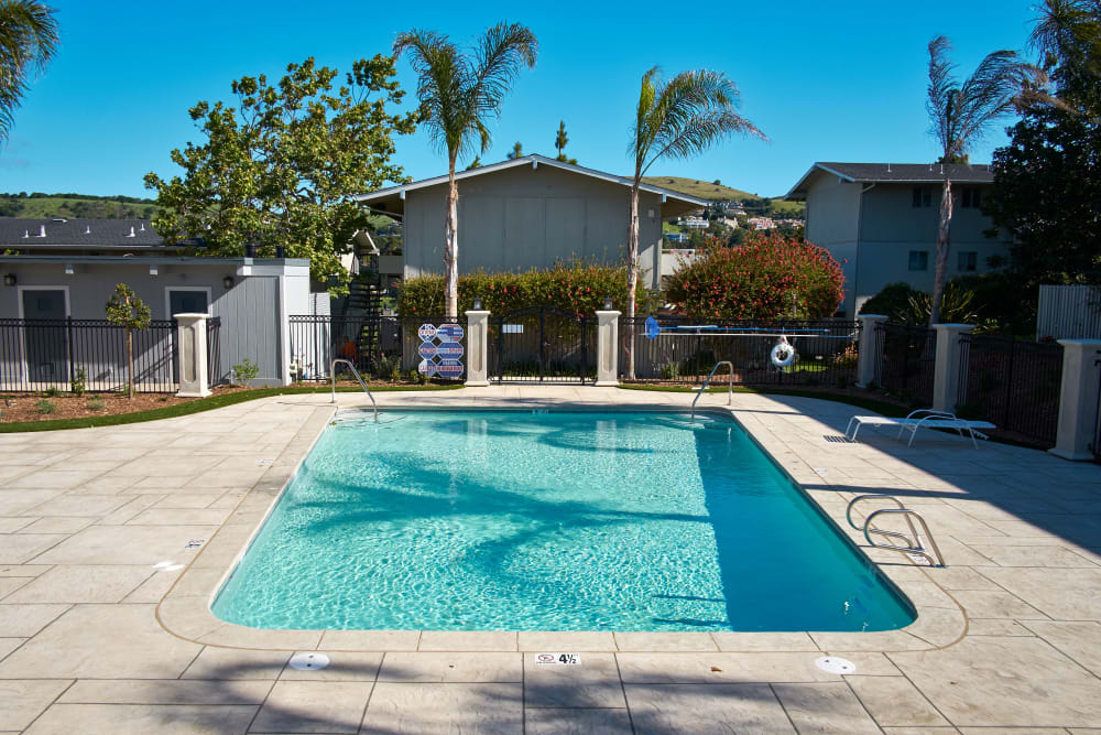Swimming pool on a beautiful day at Breakwater Apartments in Santa Cruz, California