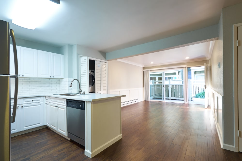 Kitchen with hardwood floors at Breakwater Apartments in Santa Cruz, California