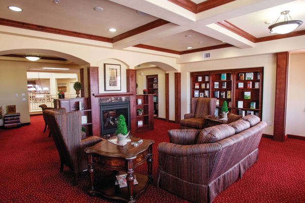 Plenty of comfortable seating in the library at Alexis Estates Gracious Retirement Living in Allen, Texas