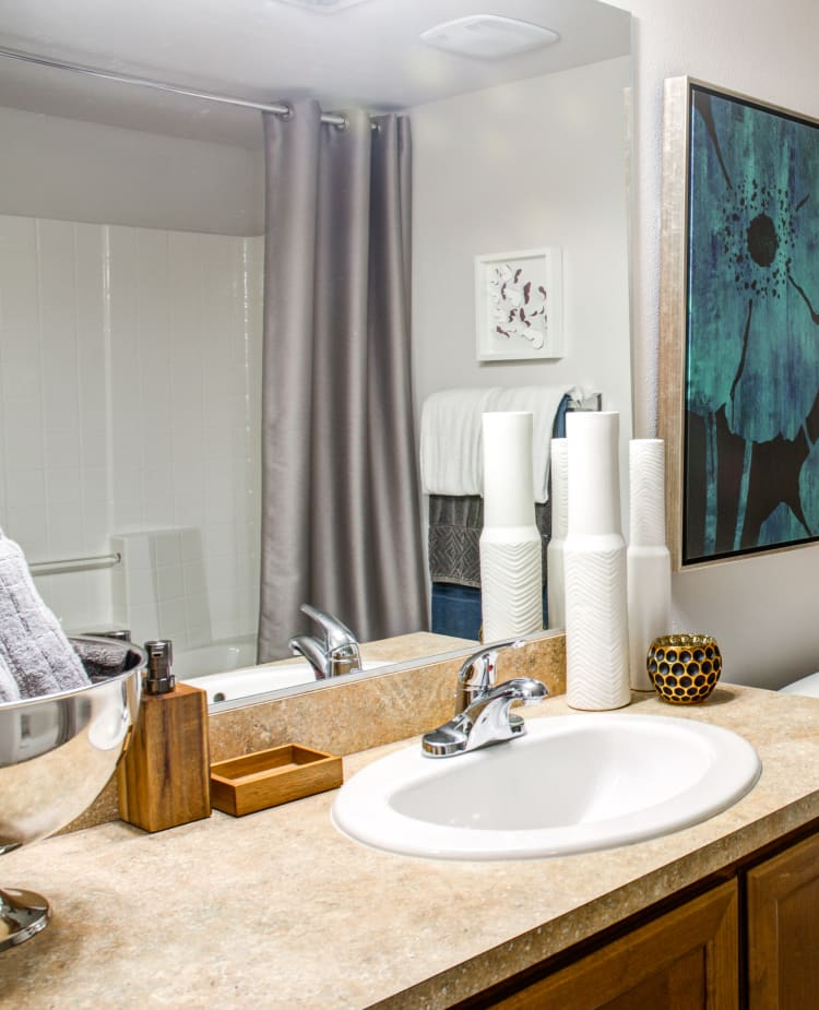 Large vanity mirror and ample counter space in a model home's bathroom at Sofi at Cedar Mill in Portland, Oregon