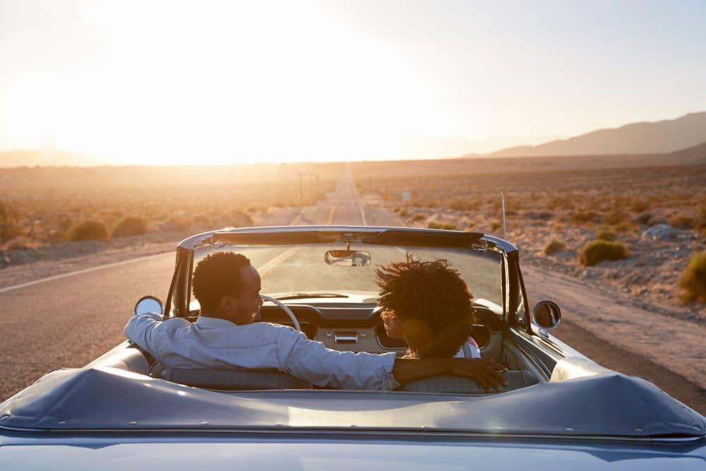 Couple driving in Palm Springs, California near Devon Self Storage