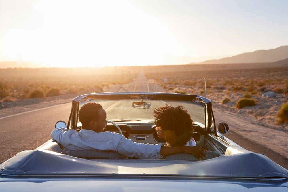 Couple driving in Palm Springs, California near Devon Self Storage