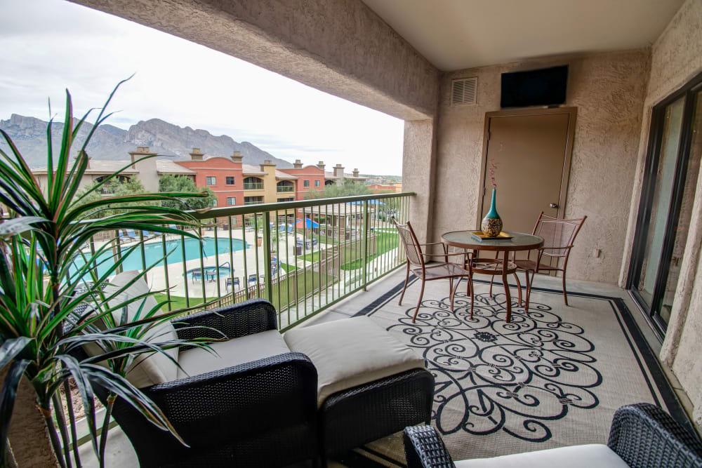 Patio furniture on balcony at Oro Vista Apartments in Oro Valley, Arizona