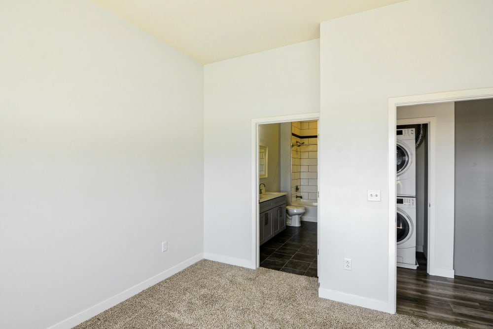 Bedroom with glimpse of Washer & Dryer at Steelyard in St. Louis, Missouri