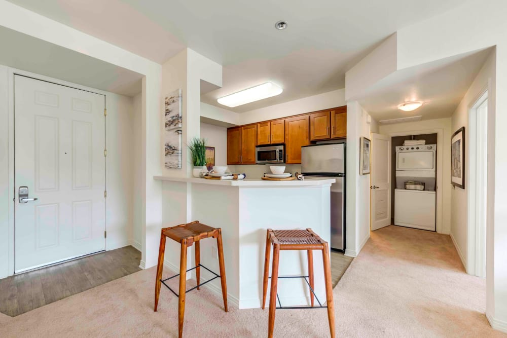 Chatsworth, CA Apartments - Sofi at Topanga Canyon Kitchen With Breakfast Bar, Wood Cabinetry, and Stainless Steel Appliances